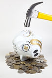 Piggy Bank Hit with Hammer Royalty Free Stock Photo