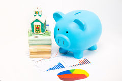 Piggy bank home pile of euro banknotes and financial documents papers Royalty Free Stock Photo
