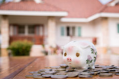 Piggy bank with home Royalty Free Stock Images