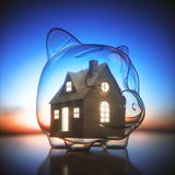 Piggy Bank Home Saving Money. Piggy bank of glass, with a miniature house lit inside. Concept of saving money for the purchase of a new house stock image