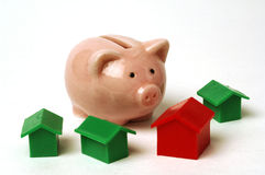 Piggy bank and house. White background Royalty Free Stock Photos