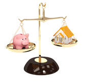 Piggy bank and house on bowls of scales Stock Photos