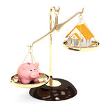 Piggy bank and house on bowls of scales Royalty Free Stock Images