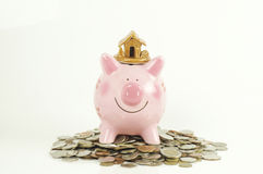 Piggy bank and house and home Royalty Free Stock Image