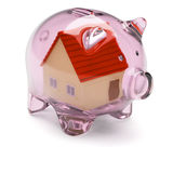 Piggy bank with house inside on white Royalty Free Stock Photo