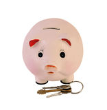 Piggy bank with house keys isolated Royalty Free Stock Images