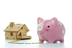 Piggy bank with house Stock Image