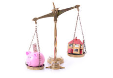 Piggy bank house scales Stock Photos