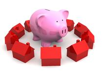 Piggy bank and houses Stock Photos