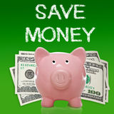 Piggy bank with hundred dollar bills. On green background - save money Stock Photography