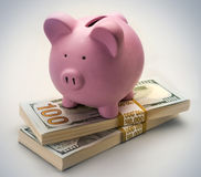 Piggy bank. On hundred dollar bills with white background Stock Photo