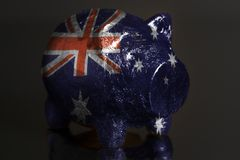 Piggy bank with Flag of Australia. Piggy bank with IFlag of Australia on a black background royalty free stock photos