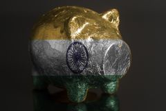 Piggy bank with Indian flag royalty free stock photos