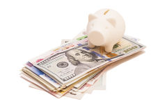 Piggy bank on international banknote Royalty Free Stock Image