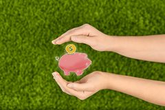 Piggy bank isolated on green background stock photography