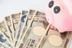 Piggy bank and japanese Yen Royalty Free Stock Photos