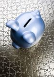 Piggy bank on jigsaws Royalty Free Stock Image
