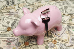 Piggy Bank With Keys On Dollar Bills Royalty Free Stock Photos