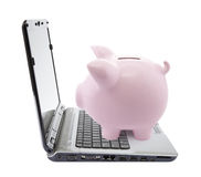 Piggy bank and laptop Royalty Free Stock Photo