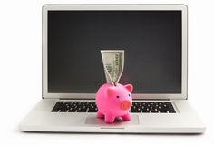 Piggy bank on laptop Royalty Free Stock Images