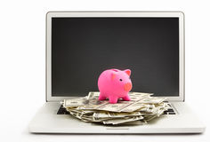 Piggy bank on laptop Royalty Free Stock Photo