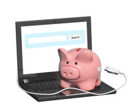 Piggy bank and laptop Stock Photo