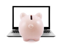Piggy bank and laptop Royalty Free Stock Image
