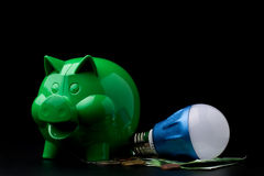 Piggy Bank with LED bulb Royalty Free Stock Photography