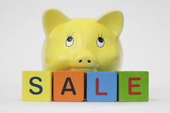 Piggy Bank with letters spelling sale Stock Image