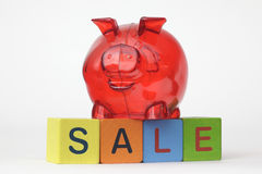 Piggy Bank with letters spelling sale Stock Images