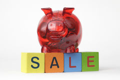 Piggy Bank with letters spelling sale Royalty Free Stock Image