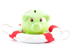 Piggy-bank with lifebelt Royalty Free Stock Photos