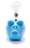 Piggy Bank and Light Bulb Stock Photos