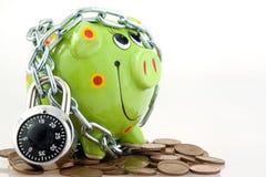 Piggy bank locked in chain Stock Photo