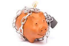 Piggy-bank locks stock image