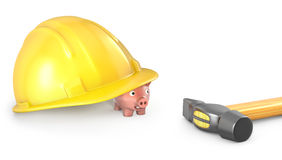 Piggy bank looks out of large helmet Stock Photography