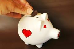 Piggy bank love of money. Piggy bank love for money concept Stock Image