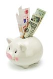 Piggy bank and major world currency notes Royalty Free Stock Photos