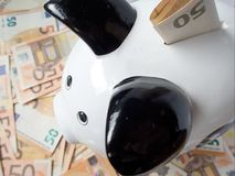 Piggy bank and many fifty euro banknotes savings investment concept. Photo Royalty Free Stock Photo
