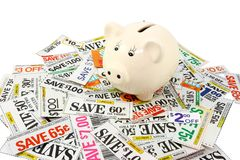 Piggy Bank With Many Grocery Coupons royalty free stock photo