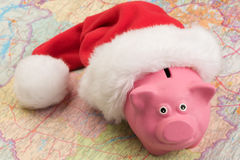 Piggy bank on the map Royalty Free Stock Image