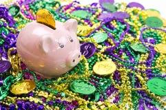 Piggy Bank with Mardi Gras Coins Stock Photos