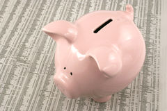 Piggy bank on market report Stock Images