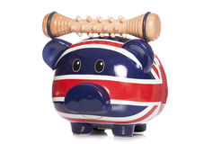 Piggy bank with massage tool Stock Photo
