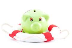 Piggy-bank met lifebelt Royalty-vrije Stock Foto's