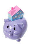 Piggy Bank with Miniature House Stock Photography