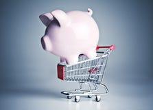 Piggy bank on a miniature shopping cart Stock Image
