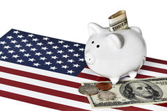 Piggy Bank with Money and  American Flag Royalty Free Stock Image