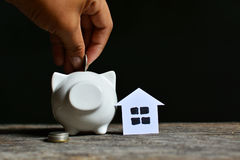 Piggy bank with money on black background. Stock Photos