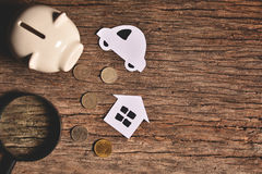 Piggy bank with money on black background. Royalty Free Stock Photo